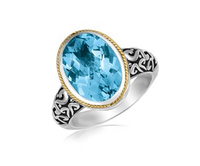 Oval Milgrained Blue Topaz Ring in 18k Yellow Gold and Sterling Silver