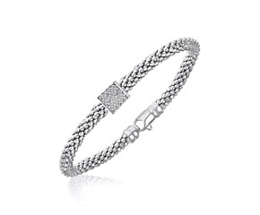 Diamond Accented Barrel Popcorn Bangle in Rhodium Finished Sterling Silver (.13cttw)