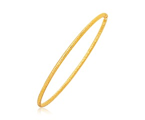 Fancy Textured Thin Stackable Bangle in 14k Yellow Gold